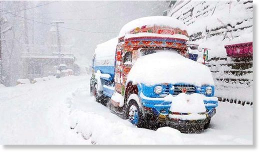 A vehicle covered in snow in Nathiagali Bazaar area of Abbottabad.