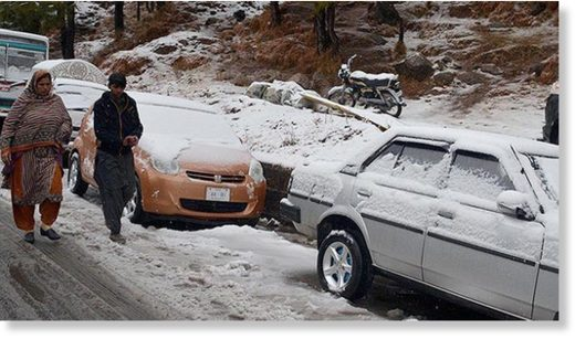 Vehicles covered in snow in Murree.