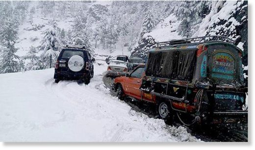 Vehicles stuck after snowfall in Shangla.