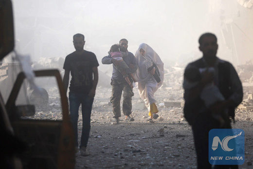 Syrians emerge from a dust cloud