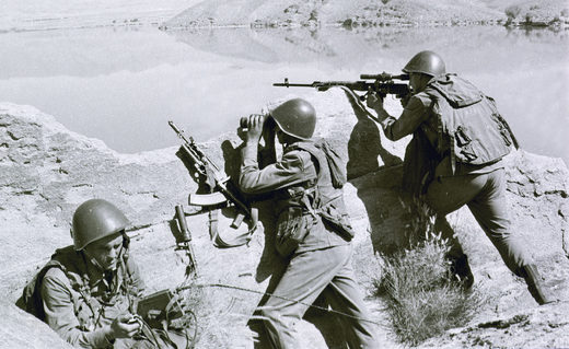 Soviet soldiers observe the highlands, while fighting Islamic guerrillas