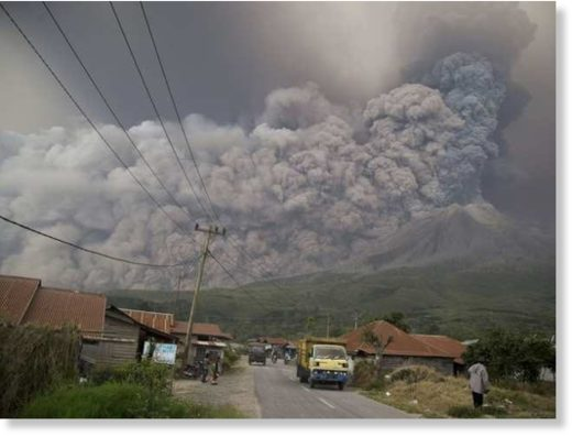 Mount Sinabung spews volcanic ash as it erupts