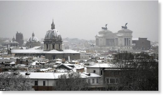 A view of Rome's snow-capped skyline, with the Monument of the Unknown Soldier seen at right, after snowfall on Monday