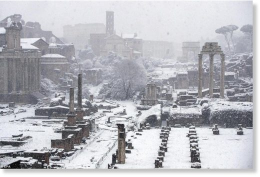 The Fori Imperiali, once the centre of the Roman Empire, is seen covered by snow in Rome on Monday morning