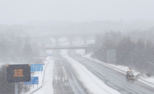 Drivers were being urged to stay off the road Thursday as snowplows cleared the way along the M80 motorway, near Castlecary, Scotland.
