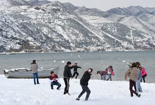 Children played in the snow at a park in Pogradec, in southeast Albania, on Tuesday.