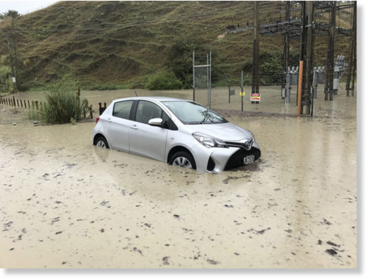 Hawke's Bay Today photographer's car caught in flooding in Eskdale area, near Napier. He only left it for 15 minutes!