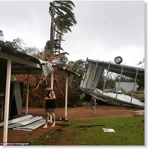 A tin roof was ripped off by the cyclone and even tipped one tin shed upside down