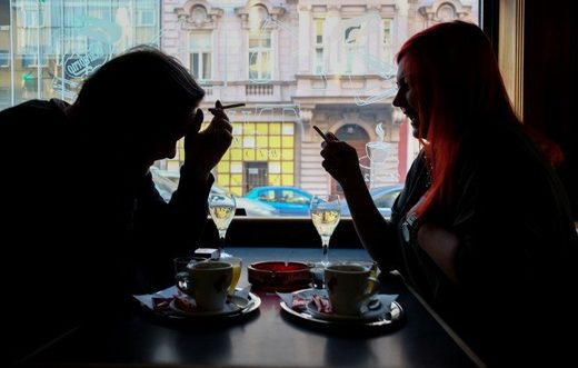 Café guests smoke cigarettes with their drinks in Vienna on March 22nd 2018.