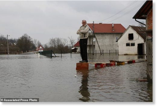 Bosnian Milan Ilic watches the level of flooded water from the Sava River in front of his house in the village of Bistrica near Gradiska, 260 kms northwest of the Bosnian capital of Sarajevo, Thursday, March 22, 2018.