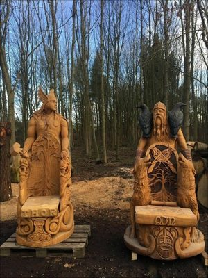 Chainsaw carved Thor and Odin throne