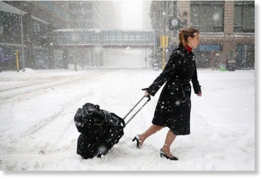 Delta Airlines flight attendant Victoria Flees trudged through the snow with her bags in downtown Minneapolis