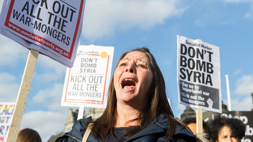 protest outside Downing Street over British attack on Syria