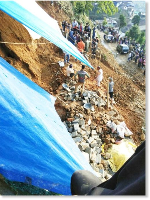 Volunteers making efforts to dig out victims buried under landslide debris in Mokokchung town on Saturday.