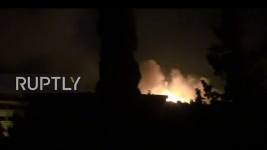 Screen shot from a footage showing large explosion at a Syrian military base in the province of Hama