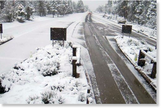 A remote camera at the south gate entrance at the Grand Canyon National Park, Ariz., shows a fresh dusting of snow.