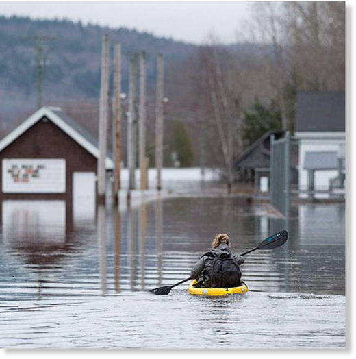 Darlings Island, N.B., where the Kennebecasis River has flooded the only road into the community.