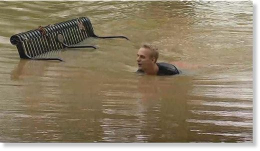 NBC4 caught one resident taking a dip in the flood water!