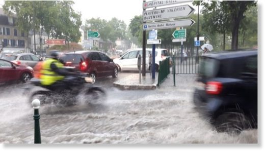 Drivers struggle on the Paris roads after rainfall caused flash floods