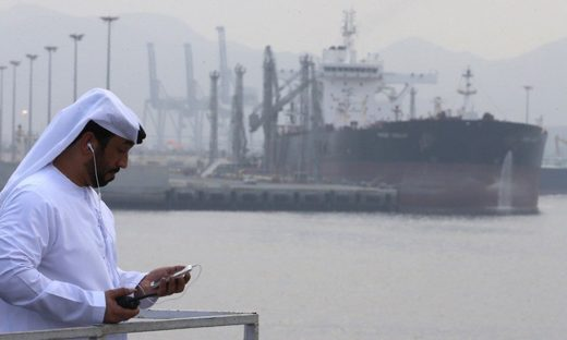 A man stands at an oil terminal at Fujairah, in the United Arab Emirates