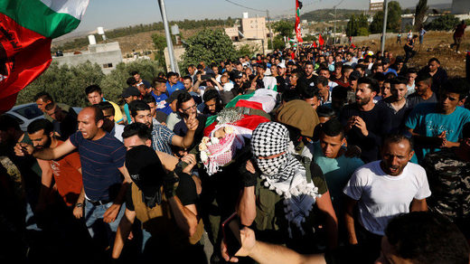 Mourners carry the body of Palestinian Izz ad-Din Tamimi
