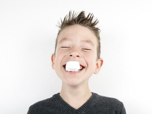 kid eating marshmallow