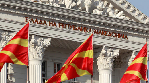 Macedonian flags fly in front of the government building in Skopje