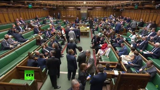MPs voting in House of Commons