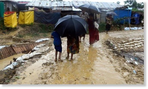 A landslide triggered by heavy monsoon rains killed at least 12 people in Bangladesh's border district of Cox's Bazar