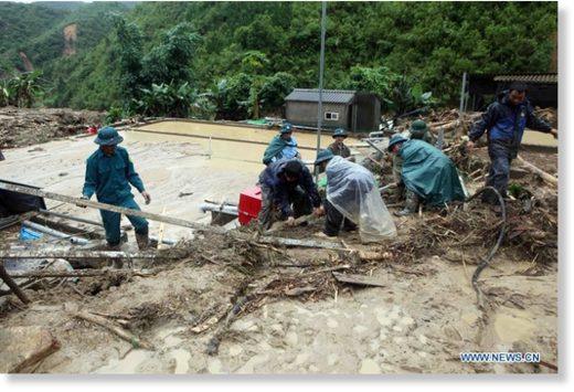Rescuers work at the flood-affected area in Lai Chau province, north of Vietnam, on June 25, 2018.