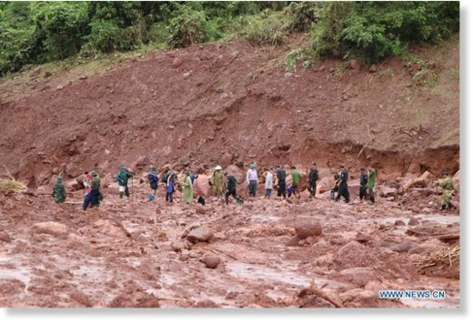 Rescuers clear ruins after a landslide in Vietnam's northern Lai Chau province, on June 27, 2018.