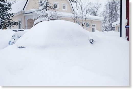A car buried under snow in Luleå.