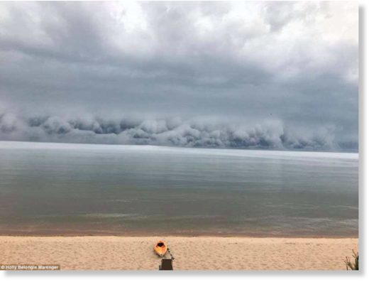 A terrifying wall of cloud has been caught on camera ominously rolling to wards the shore.