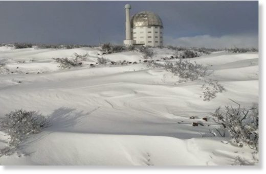 The SALT Observatory in Sutherland is surrounded by snow.
