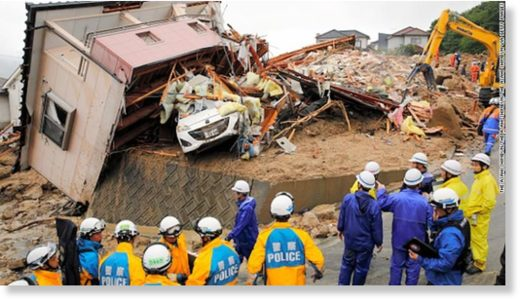 Rescue operations continue at a collapsed house on July 8, 2018 in Kumano, Hiroshima, Japan.