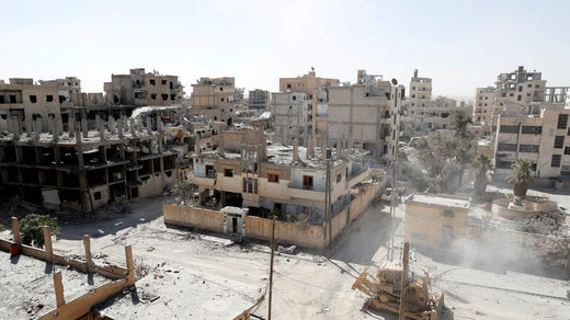 Damaged buildings in Raqqa, Syria