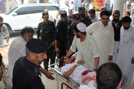A Pakistani yougman injured in a bomb blast is transported at a hospital in Bannu