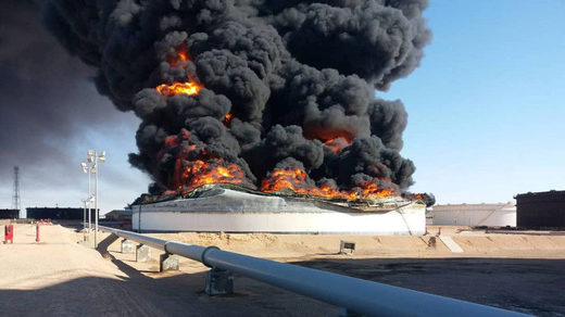 Smoke and flame rise from an oil storage tank that was set on fire amid fighting between rival factions at Ras Lanuf terminal, Libya  Reuters