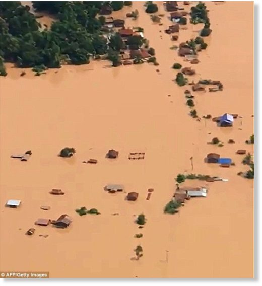 Aerial images taken the day after the dam collapsed show flooded plains and fully submerged houses in the Attapeu province