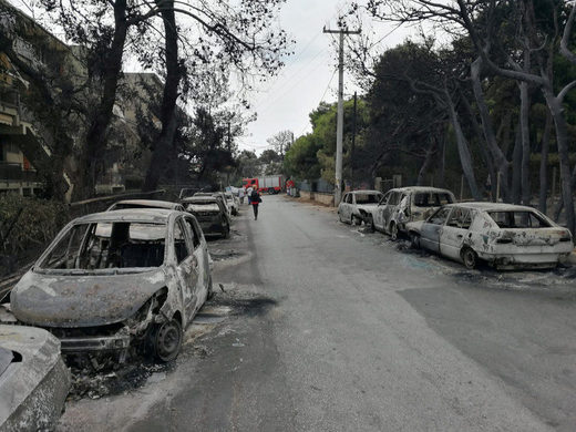 The aftermath of a wildfire is seen in Mati, Greece