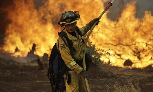 A firefighter battling the wildfire in Redding, California