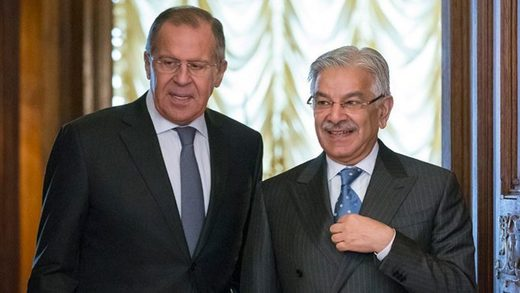 Russian Foreign Minister Sergei Lavrov, left, welcomes Pakistani Foreign Minister Khawaja Muhammad Asif during a visit to Moscow