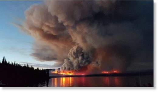 A wildfire burns on Eutsuk Lake in North Tweedsmuir Park south of Houston.