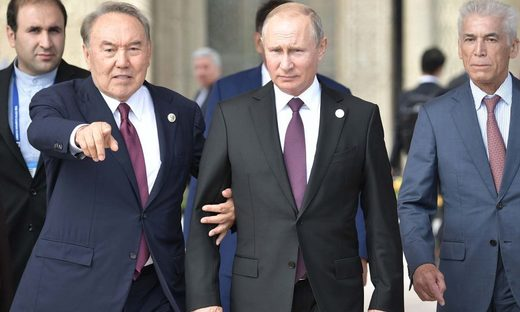 Russian President Vladimir Putin and Kazakhstan President Nursultan Nazarbayev walk along a Caspian Sea embankment while participating in the Fifth Caspian Summit in Aktau, Kazakhstan.