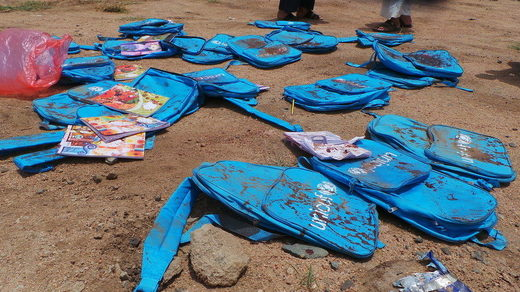 Children's backpacks at the site of an airstrike in Saada
