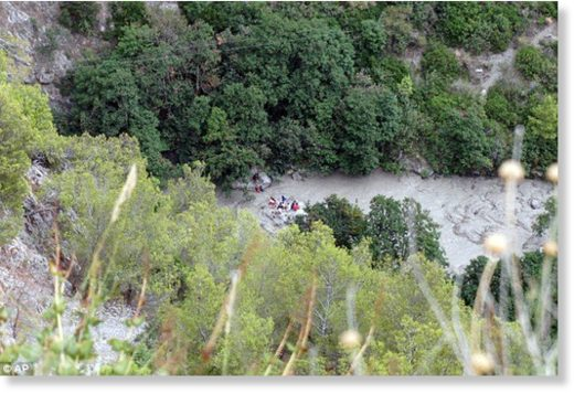 Rescuers work at the Raganello Gorge
