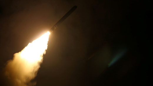 The US Navy guided-missile destroyer USS Laboon fires a Tomahawk