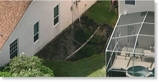The sinkhole opened between the two houses and is 20 feet deep and 40 feet wide.