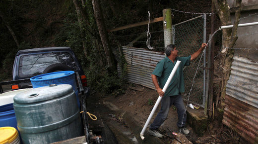 Man collects mountain spring water in Puerto Rico
