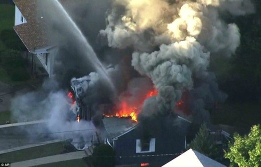 More than 50 properties explode in flames in three Boston suburbs after 'gas main meltdown'